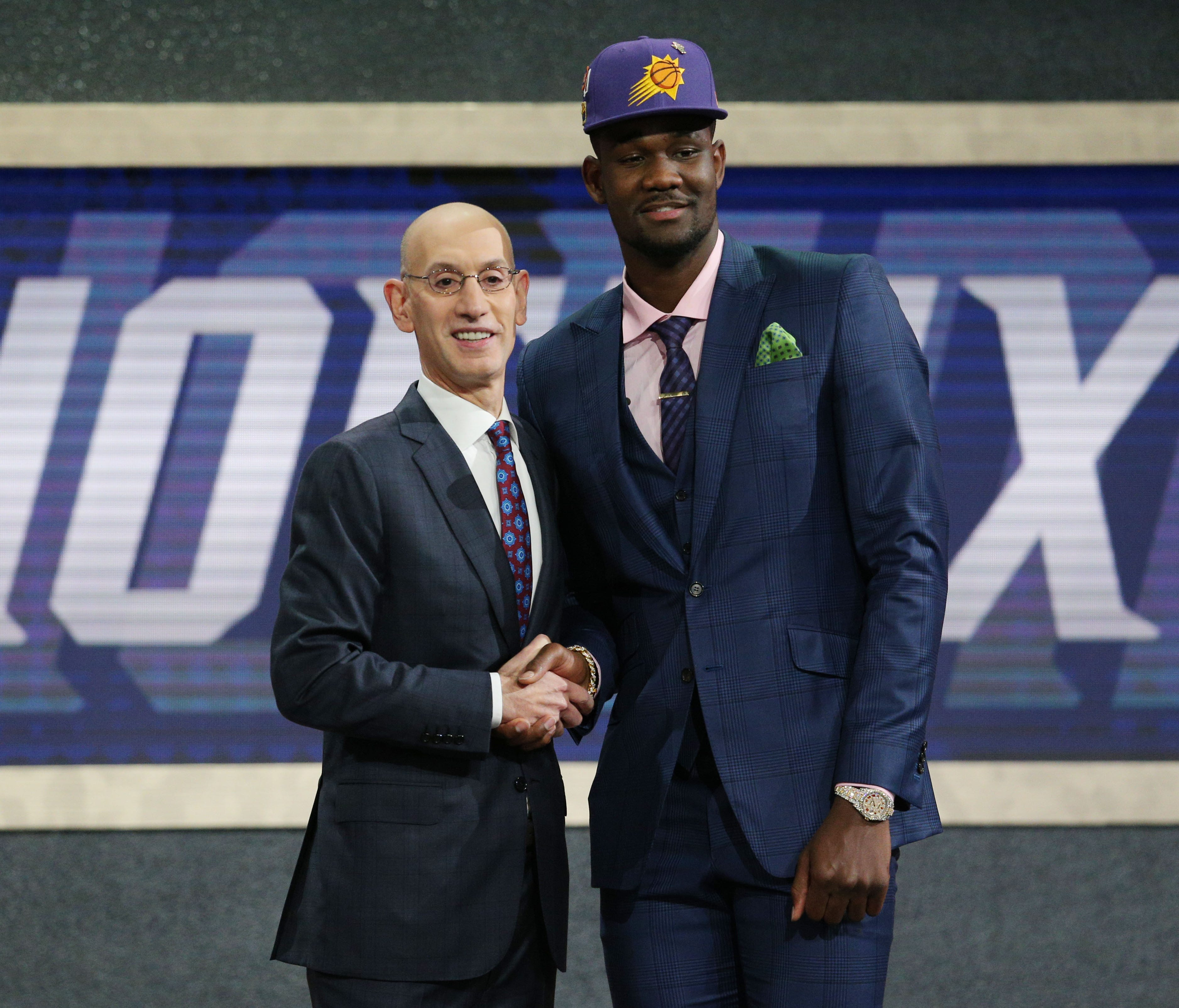 Deandre Ayton (Arizona) greets NBA Commissioner Adam Silver after being selected as the No. 1 pick in the 2018 NBA draft.