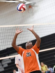 Palmyra's Abel Gebre (21) sets the ball for a teammate