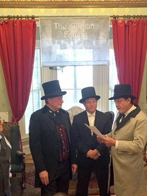 From left, Silver City mayor Ken Ladner, former mayor Edward Morones and Grant County assessor Raul Turrieta were reading the highlights of the Territorial Charter of 1878 at the Silver City Musem on Saturday.