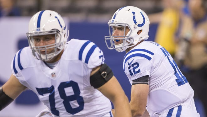 Andrew Luck, Colts quarterback, takes a snap from Ryan Kelly, during pregame warmups, Colts vs. Baltimore Ravens, preseason at Lucas Oil Stadium, Saturday, Aug. 20, 2016.
