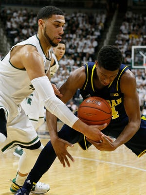 Michigan State's Denzel Valentine steals the ball from Michigan's Aubrey Dawkins on February 1, 2015 in East Lansing. The two teams meet again Tuesday in Ann Arbor.