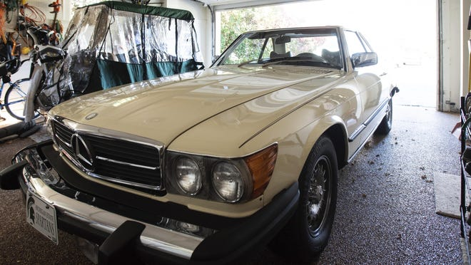 """Tom Jamieson's 1979 Mercedes-Benz 450 SL sits in a garage in Lansing on Wednesday, Oct. 28, 2020. Jamieson who bought the car from Earvin """"Magic"""" Johnson in the 1980s, is now selling it, listing it for sale online for $24,000, according to the Lansing State Journal."""
