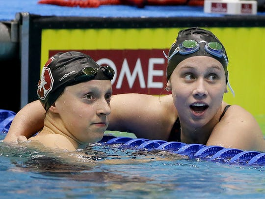 Stanford's Katie Ledecky, left, and Louisville's Mallory Comerford, right, tied for first place in the Women's 200 Yard Freestyle at the NCAA Women's Swimming & Diving championships Friday at the Natatorium at IUPUI in Indianapolis.