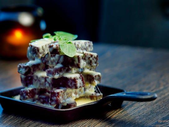 Kepta Duona, crispy rye bread tossed in duck fat aioli and Havarti cheese at Sonata's Restaurant.