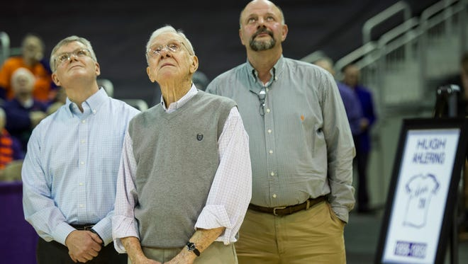 Former University of Evansville basketball player Hugh Ahlering, middle, watches as he is honored during a halftime jersey retirement ceremony at the Ford Center on Saturday, Jan. 27, 2018.