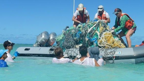 """Marine Debris Removal in the Northwestern Hawaiian Islands: A team of 17 NOAA divers helped remove 7,436 hard plastic fragments, 3,758 bottle caps, 1,469 plastic beverage bottles and 477 lighters and an 1 1 1/2 ton """"super net."""""""