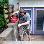 Shawn Johnson pressure washes a house in West Asheville Friday morning. Johnson has become almost an urban legend among the 15,000 members of the West Asheville Exchange Facebook group. Down on his luck, Johnson found a supportive community and offers for handyman work as Shawn of All Trades.