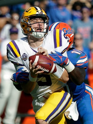 LSU quarterback Joe Burrow, left, is sacked by Florida linebacker Vosean Joseph during the first half of an NCAA college football game, Saturday, Oct. 6, 2018, in Gainesville, Fla. (AP Photo/John Raoux)
