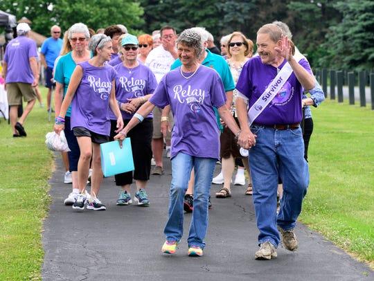 Cancer survivors Patti Tucker and Chuck Dagg lead the