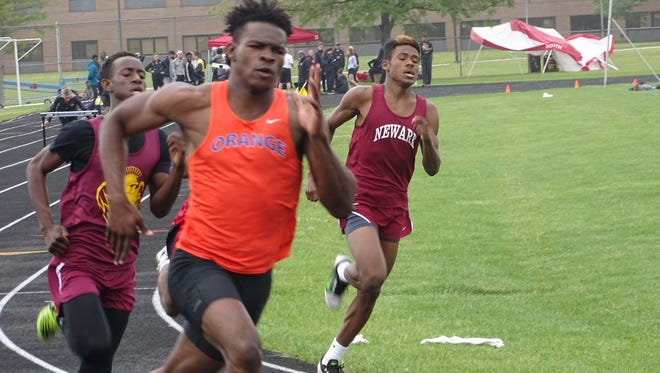 Newark freshman Bobby Crenshaw, right, competes in the 400 on Saturday during the Division I District 1 meet at Hilliard Darby. Crenshaw placed fourth to qualify for the regional meet.