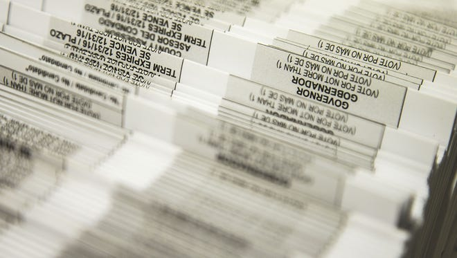 Hundreds of thousands of early voting ballots gets printed at Runbeck Election Services in Tempe on Friday July 25, 2014.
