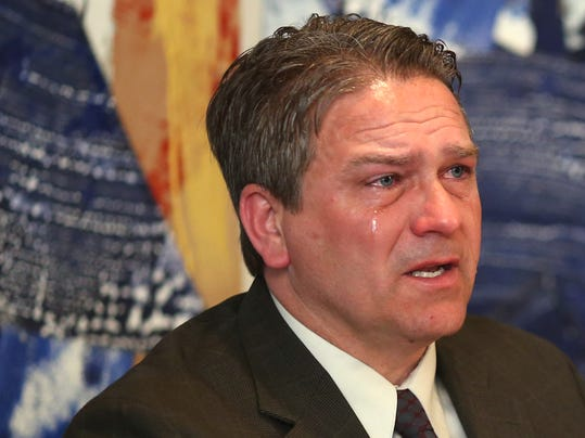 Todd Hoffner, former football coach at Minnesota State, Mankato, tears up as he talks about getting back to coaching football after being fired  more than a year ago, during a news conference Tuesday, April 15, 2014, in Minneapolis. Hoffner will return to his old job after an arbitrator ruled he was wrongfully terminated, saying the decision wasn't easy but that it would help him and his family heal. (AP Photo/Star Tribune, Kyndell Harkness) MINNEAPOLIS-AREA TV OUT  MAGS OUT  ST. PAUL OUT