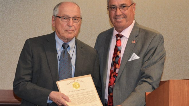 Freeholder Director Ronald G. Rios (right) led the Freeholder Board in recognizing Leonard J. Roseman (left) for his years of dedicated service at its meeting on May 17.