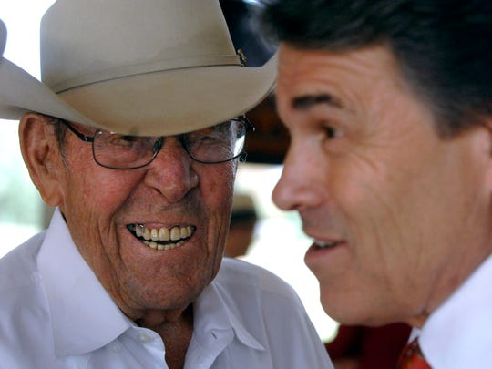 Ray Perry, seen here laughing with his son, then-Governor Rick Perry, at an Abilene campaign event in 2010 at Frontier Texas!.