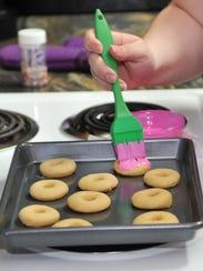 Stacey Hohertz decorates gluten-free wafers. Hohertz