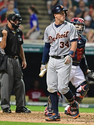Tigers catcher James McCann (34) walks to the dugout after striking out in the fourth inning Friday in Cleveland.