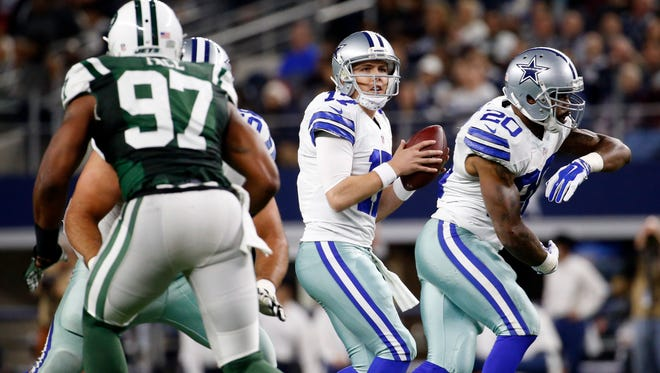 Dallas Cowboys quarterback Kellen Moore (17) throws during the first half against the New York Jets at AT&T Stadium.