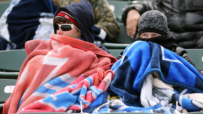 The temperature hovered in the mid 30s but that didn't bother Wings fans Raquel Stuewe (L) and Sheila Hayes on opening day at Frontier Field.
