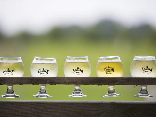 A flight of ciders from Embark Craft Ciderworks made