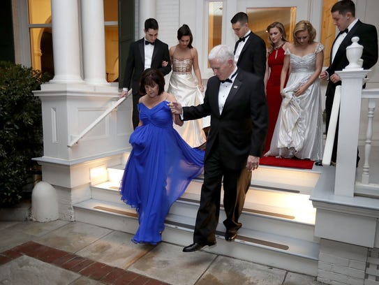 Vice President Mike Pence helps wife, Karen, down the