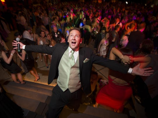 WZPL radio personality Dave Smiley shown here hosting hundreds of adults for the annual WZPL Smiley Prom at the Egyptian Room in Old National Centre in April.