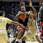 Feb 28, 2015; Tallahassee, FL, USA; Florida State Seminoles guard Xavier Rathan-Mayes (22) defends Louisville Cardinals guard Terry Rozier (0) during the game at the Donald L. Tucker Center. Mandatory Credit: Melina Vastola-USA TODAY Sports