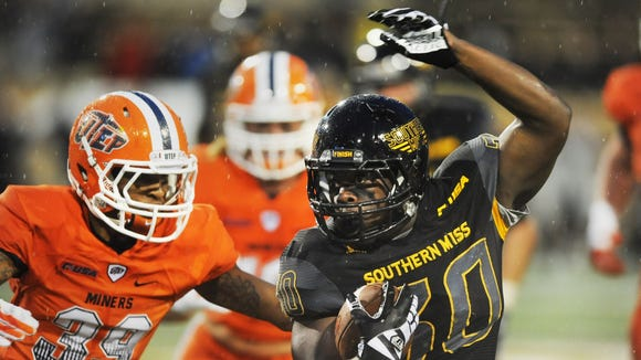 Southern Mississippi running back Jalen Richard breaks through UTEP defense during an NCAA college football game Saturday, Oct. 31, 2015, in Hattiesburg, Miss.