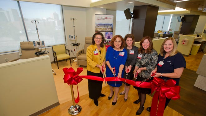 MD Anderson Cancer Center at Cooper recently opened its newly expanded infusion in Camden. From left, Dr. Generosa Grana, the cancer center's director; Susan Bass Levin, president and chief executive officer of The Cooper Foundation; Christine Winn, senior vice president MD Anderson Cooper Cancer Institute; Adrienne Kirby, president and chief executive officer  of Cooper University Health Care; and Mary Jane Durkin, infusion nurse.
