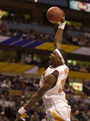Tennessee's Ron Slay dunks during the 2001 SEC Tournament, the first in Bridgestone Arena.