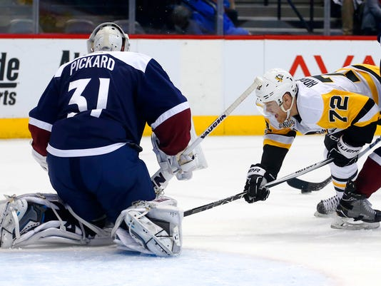 Pittsburgh Penguins right wing Patric Hornqvist (72) dives while taking a shot on Colorado Avalanche goalie Calvin Pickard (31) during the second period of an NHL hockey game, Thursday, Feb. 9, 2017, in Denver. (AP Photo/Jack Dempsey)