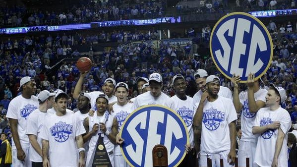 Kentucky basketball celebrates the SEC Tournament championship in Nashville, Tenn., and a perfect 34-0 record.