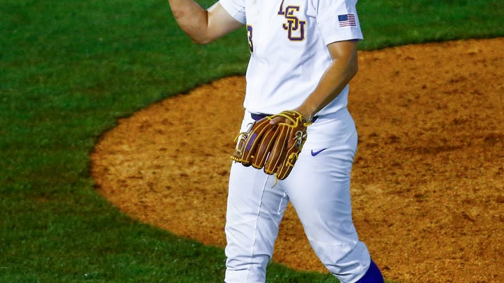 Todd 'Superman' Peterson pitches, hits, fields LSU to 6-4 win over S.C. to stay in tourney
