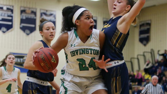 Irvington's Grace Thybulle (24) drives to the basket