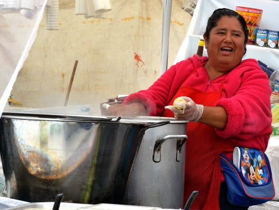 Julieta Lira of Brandon's food tent prepares tamales