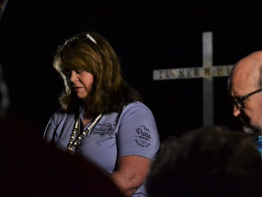 Cindy Hipps leads a prayer for her son, Tucker Hipps, on the morning of the third anniversary of his death. Tucker Hipps died on Sept. 22, 2014.
