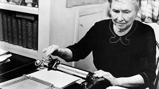 """Author and humanitarian Helen Keller, who is deaf and blind since childhood, is shown during her documentary film, """"The Unconquered,"""" on June 18, 1954. The movie, also known as """"Helen Keller in Her Story,"""" won an Academy Award as the best feature length documentary in 1955."""