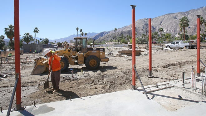 A worker works on the construction of the Arrive hotel in uptown Palm Springs. A worker works on the construction of the Arrive Hotel in uptown Palm Springs, Wednesday, March 25, 2015.