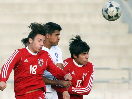 Eastlake's Jonathan Salas, center, is double teamed by Omar Castillo, 18, and Andres Macias, 12, of Jefferson while the trio went up for a header during their Class 5A regional quarterfinal playoff game Tuesday at the Socorro Student Activities Complex.