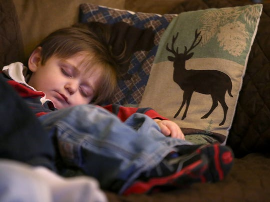 Two-year-old Christian Fortner sleeps on the couch at his home in Trenton, Tenn., on Friday, Dec. 9, 2016.