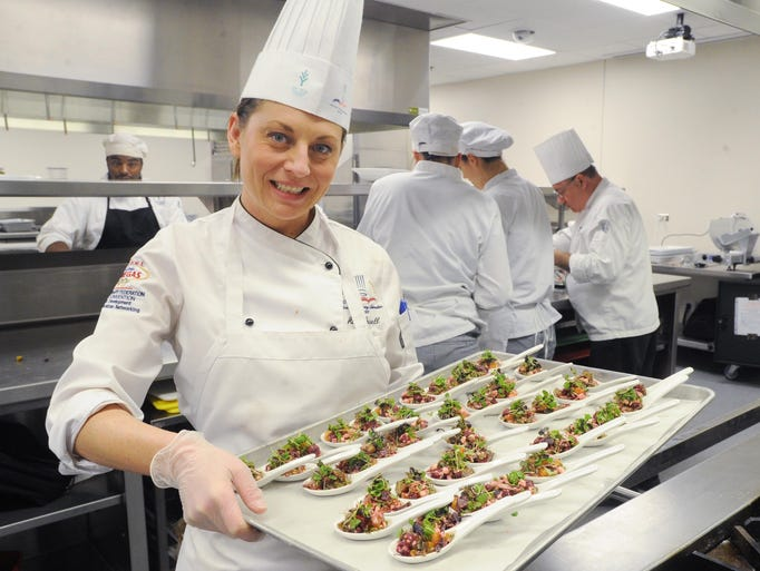 Powell holds the finished roasted beet salad with goat cheese, mint and honey she will serve at the reception. Anna Powell, a culinary student at Ivy Tech is the chef in charge of catering a reception for 200 at a Martha Stewart speaking engagement Novemeber 4, 2013 at the school. She and other students are seen preparing just before the event.