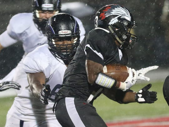 CHCA 's Darian Woods (67) tackles Indian Hill's   Tennyson