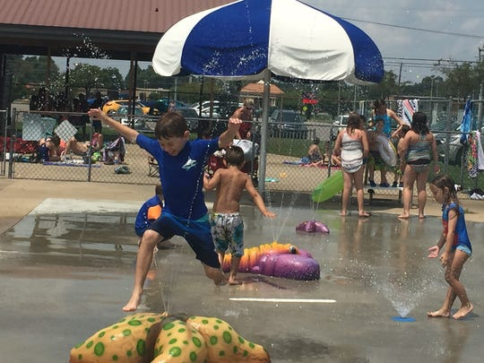 Jacob Jolley of Clarksville cools off and celebrates his eighth birthday Tuesday at Beachaven Pool as temperatures crept above 90 degrees.