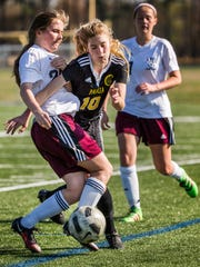 Appoquinimink's Ashley Hickman (left) collides with Padua's Ashlee Brentlnger (right) in the second half of Padua's 4-0 win over Appoquinimink at Appoquinimink High School on Wednesday afternoon.
