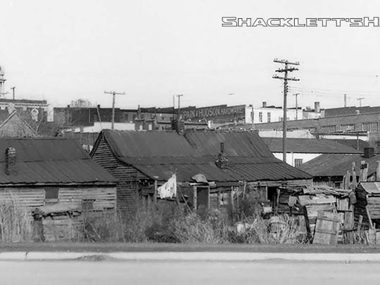 The Bottoms, once located south of the historic Public Square in Murfreesboro, was prone to flooding. During Urban Renewal, families were moved out to make way for what is now Broad Street. The 'shantytown' was constructed of any materials the low-income residents could find.