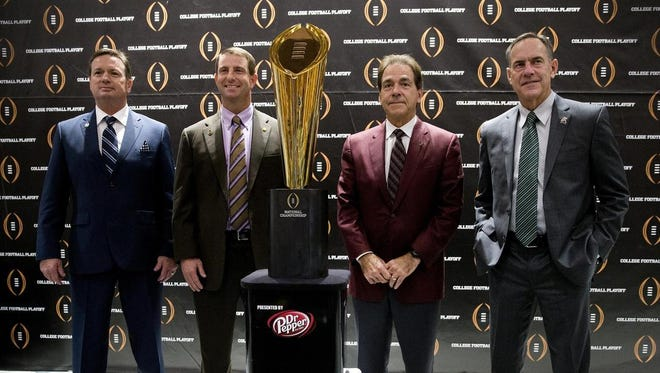 Oklahoma's Bob Stoops, left, and MSU's Mark Dantonio, right, join Clemson's Dabo Swinney and Alabama's Nick Saban at the press conference for the College Football Playoffs on Dec. 10, 2015 in Atlanta.