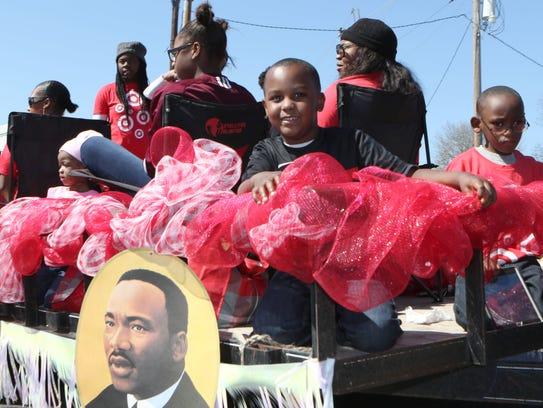 Parade goers line Desiard Street as the Black History