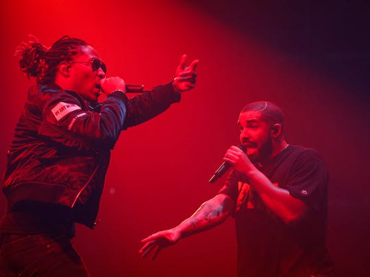 Hip-hop artist Future, left, performs with Drake to
