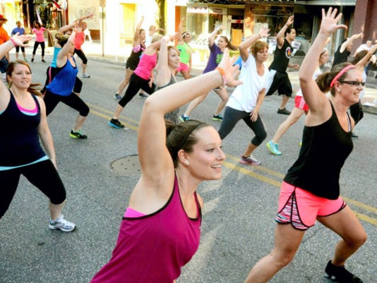Zumba dancers participate in the Can-Am Police and Fire Games Zumba Block Party fundraiser last summer in York City. A Zumbathon on Saturday morning will benefit the American Heart Association through Memorial Hospital's Heart Walk Team.