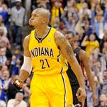 Indiana Pacers forward David West reacts to hitting what would be the game winning three-point basket against the Miami Heat inside Bankers Life Fieldhouse, Wednesday, March 26, 2014, in Indianapolis. The Pacers won the game 84-83.