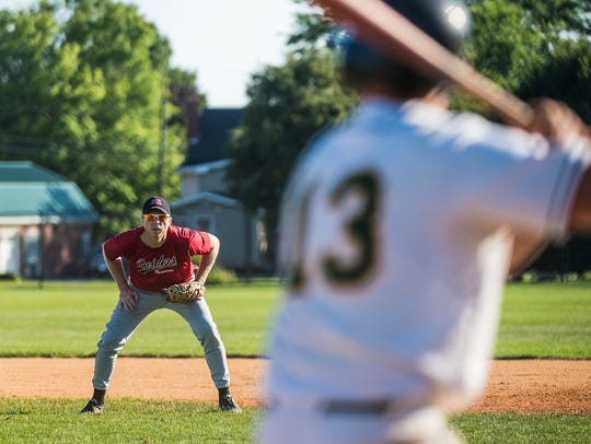 Hanover's Bobby Taylor watches as New Oxford bats during